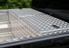 Aluminium Gull winged lidded box flush with top rail in a Nissan navara D40