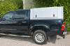 Toyota Hilux Doible Cab with a Gullwing Canopy fitted, which has been powder coated silver.