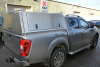 Nissan NP300 with Roof Bars and plain aluminium doors.