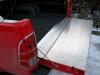 Aluminium tailgate with flappy piece on a aluminium piano hinge.