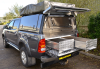 Toyota Pickup fitted with an Integral Drawer System, Canopy colour coded and Customers Tent.