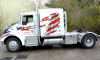 American Tractor Unit showcasing N & J Diamond Brite Boxes.