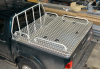 Front Gull winged Box with rails and rear lift up Tonneau cover with port holes for dogs.