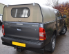 Toyota Hilux Agrican fitted with a  Solid rear door and window.