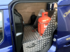 Side door pull out drawer housing Horseshoes and unit to house gas bottles securely.