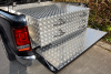Slide out Drawer unit housing four drawers and fitted underneath a fibre glass tonneau cover.